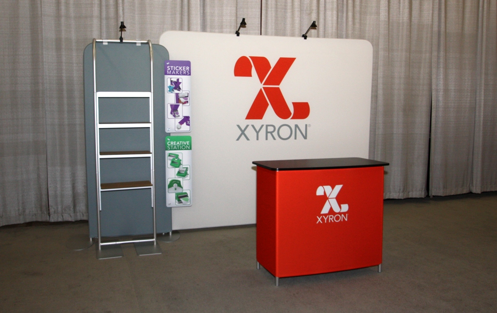 Portable shelving unit in a custom trade show exhibit