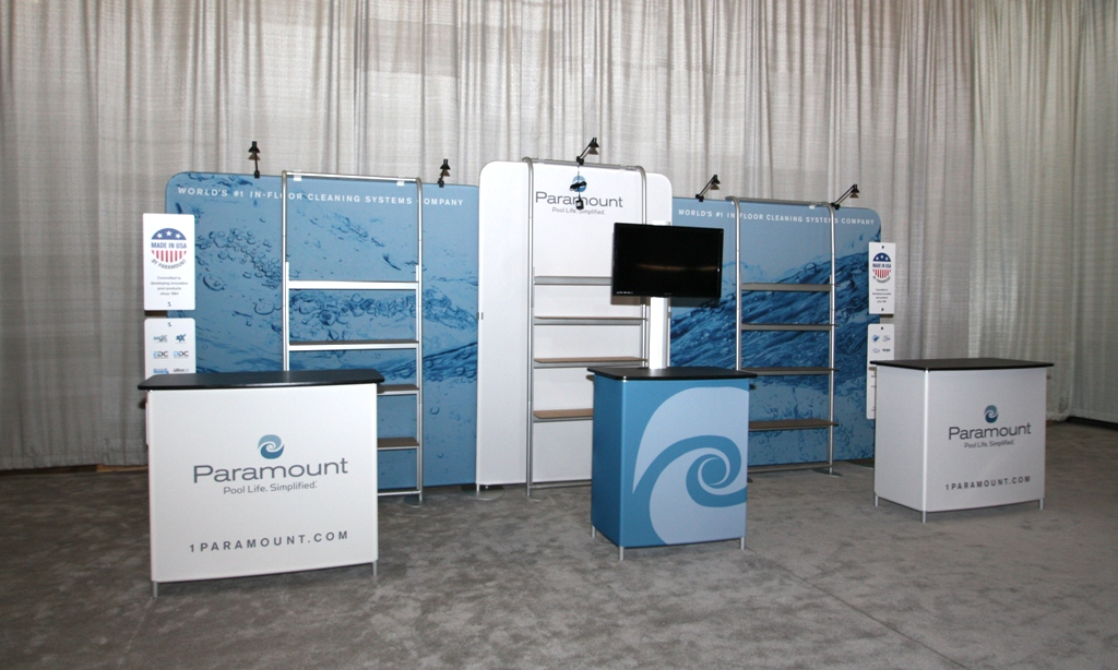Portable shelving units in a custom trade show display